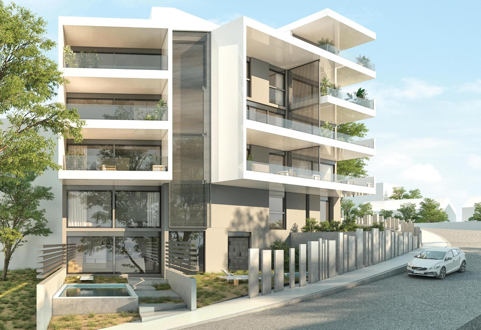 external view of modern apartment complex with greenary and parking